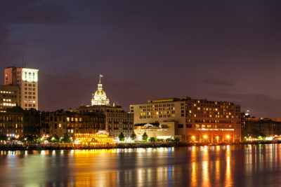 Illuminated waterfront Savannah Historic District at night